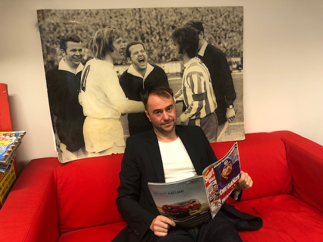 Christian Falk in his office, right after answering our interview questions, with a photo of Netzer and Overath behind him.